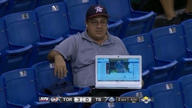 Tampa Bay rays fan watches game from his friends laptop