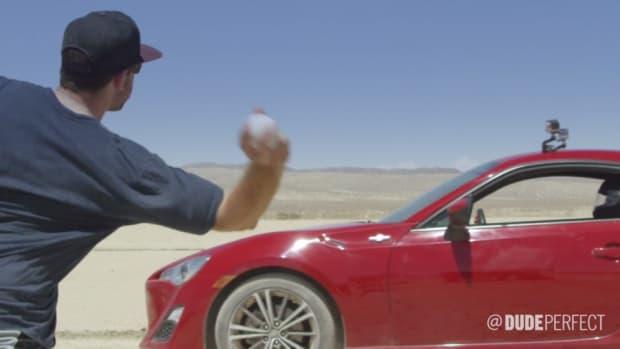 Dude perfect throws a baseball through a moving car
