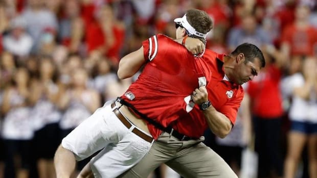 OSU strength coach tackles a student during Saturday's game