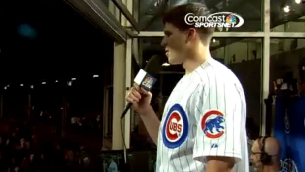 Chicago Bulls rookie Doug McDermott sings at the Chicago Cubs game