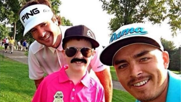 Bubba Watson and Rickie Fowler pose with Child dressed as Rickie Fowler