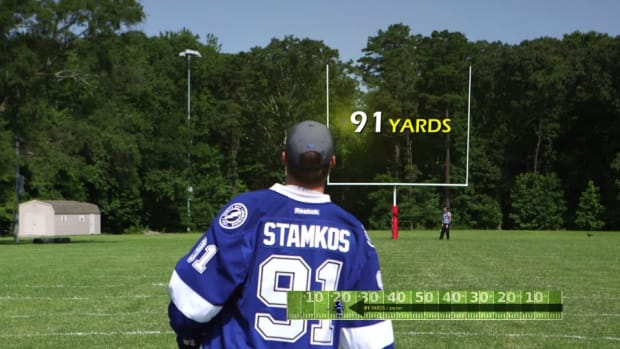 Steven Stamkos nails 91 yard field goal with puck