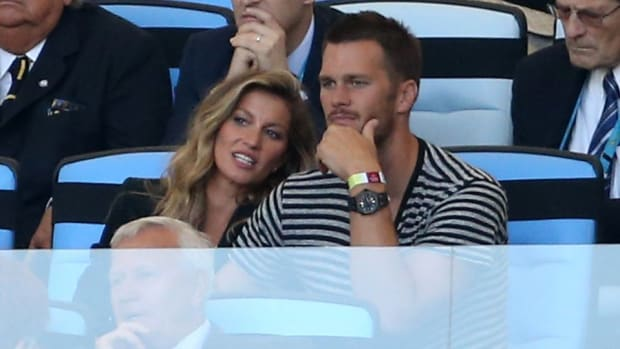 New England QB Tom Brady throws fits to get Gisele's attention