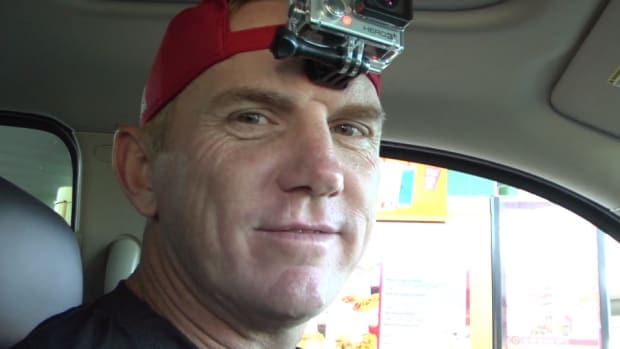 Arkansas State coach stands in traffic with a GoPro and free tickets