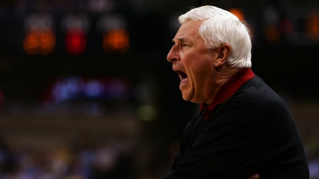 Bobby Knight hit a cow and totaled his car, but walked away