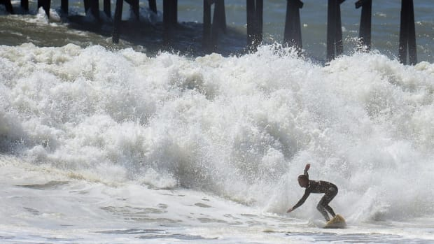 Surfers ride Hurricane Marie Waves