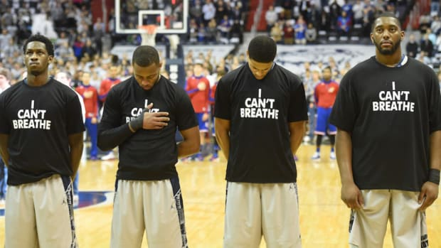 High school bans 'I can't breathe' t-shirts at basketball tournament - image