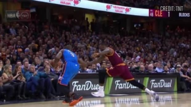 LeBron James crashes into Jason Day's wife, Ellie, on sideline--IMAGE