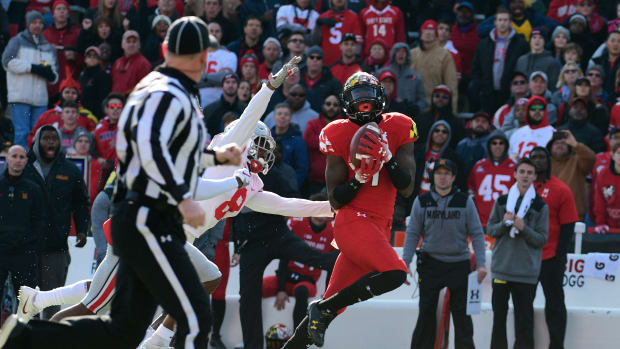 Maryland Terrapins wide receiver Dontay Demus (7) catches a pass in from of Ohio State Buckeyes cornerback Kendall Sheffield (8) during the first quarter at Capital One Field at Maryland Stadium. Mandatory Credit: Tommy Gilligan-USA TODAY Sports