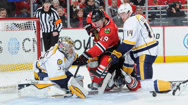 Jonathan-Toews-Predators-Bill-Smith.jpg