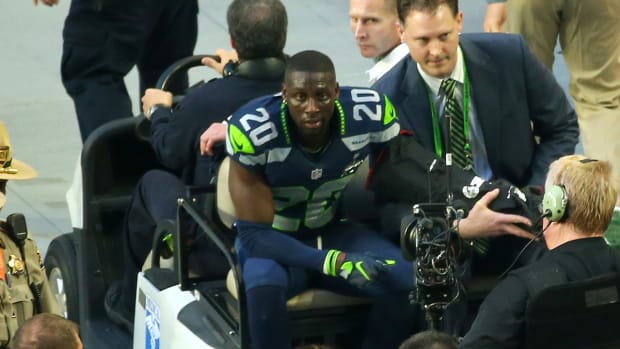 Jeremy Lane intercepts Tom Brady, leaves game with arm injury IMAGE