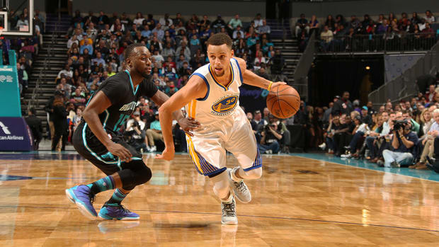 stephen-curry-paul-george-golden-state-warriors-pacers-daily-fantasy-960.jpg