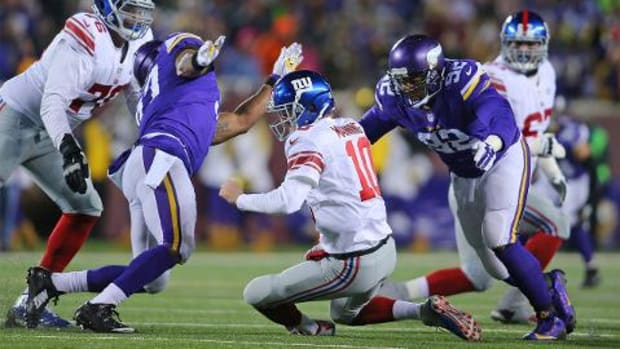 Vikings roll Giants 49-17, clinch playoff berth - IMAGE