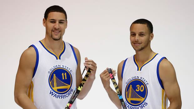 Report: Warriors' Curry, Thompson in three-point contest