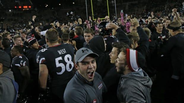 Campus Clicks: Cincinnati fans storm the field, Alabama-Georgia hype video