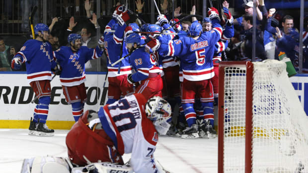 rangers-celebrate-game-7-capitals-holtby.jpg