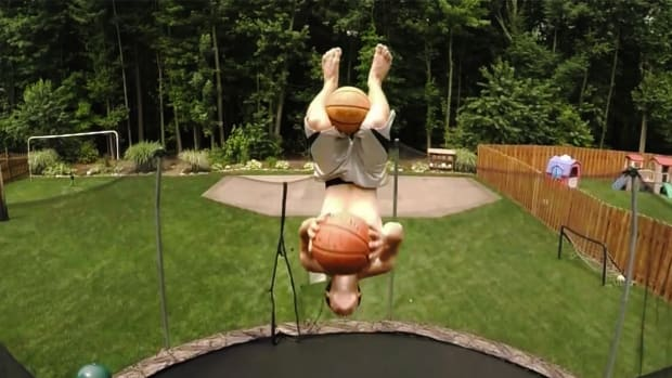 Watch: Basketball trick shot with two flips and two shots--IMAGE