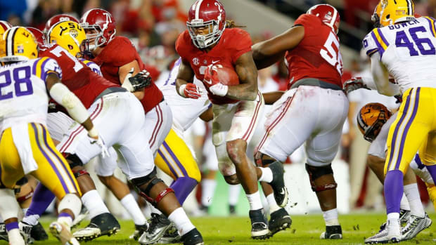 Maximum impact: Derrick Henry hits the hole like a freight train, but that isn't all he brings to Alabama
