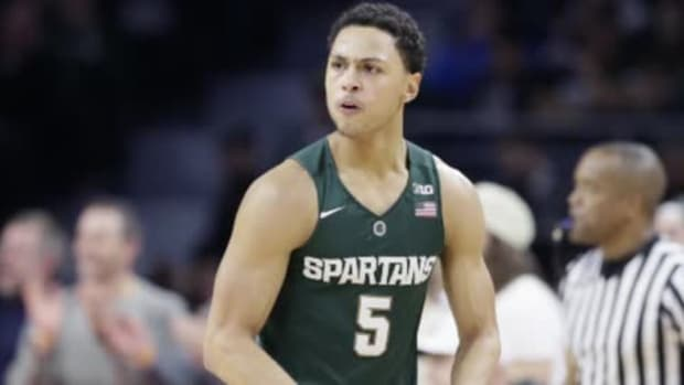 No. 1 Michigan State beats Oakland in OT - IMAGE