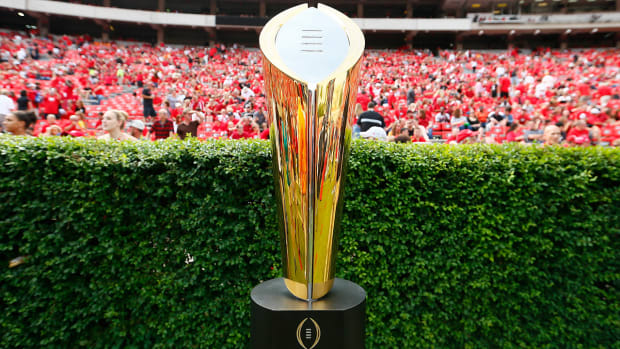 College Football Playoff to offer financial assistance for players' families IMAGE