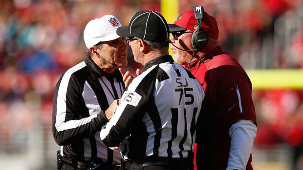 nfl_officials_huddle.jpg