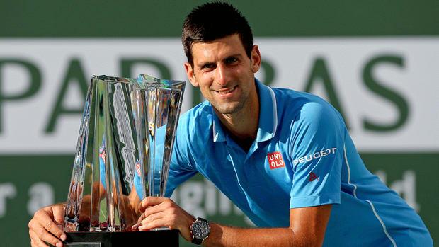 Novak Djokovic caught a Roger Federer return with just his racquet