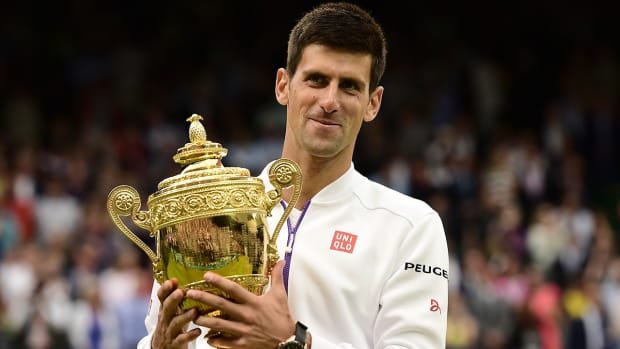 Novak Djokovic beats Roger Federer to win third Wimbledon title--IMAGE