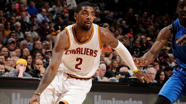 Kyrie Irving (back) out at least one game IMAGE