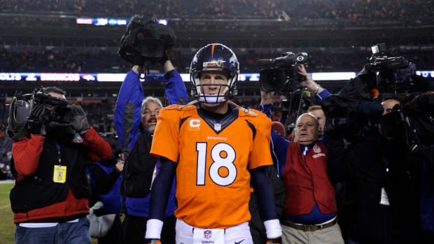 peyton manning returning 2015 denver broncos
