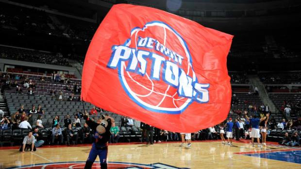 Detroit Pistons dancer makes half court shot