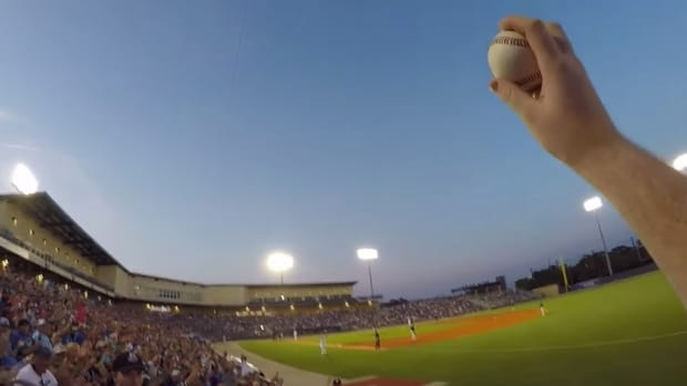 Watch a fan barehand a line drive foul ball while wearing GoPro
