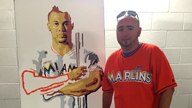 Janitor overwhelmed after his Giancarlo Stanton painting sells for $25K IMAGE