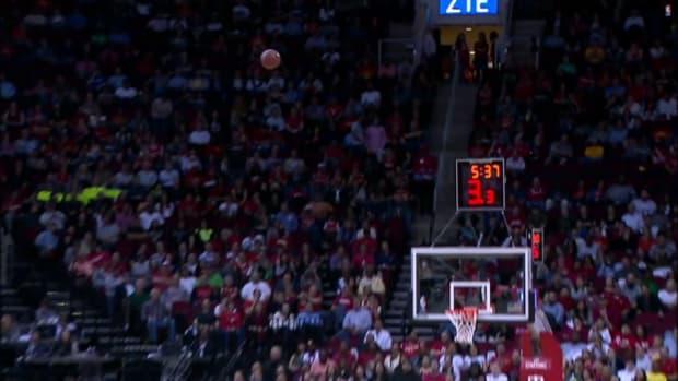 Houston Rockets fan makes half court shot for $25,000