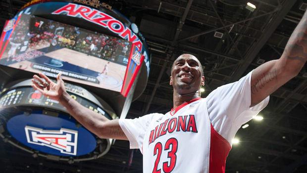 Arizona forward Rondae Hollis-Jefferson slips and falls on dunk