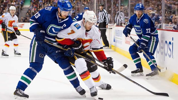Sedins-Flames-Rich-Lam-Getty.jpg