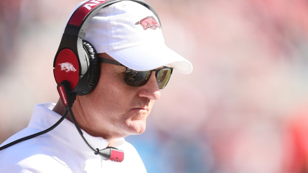 chad morris looks onto the field during an arkansas football game