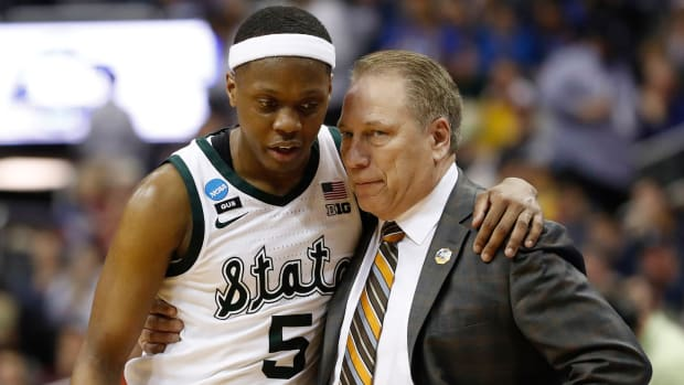 Cassius Winston and Tom Izzo speak during the 2019 NCAA Tournament.