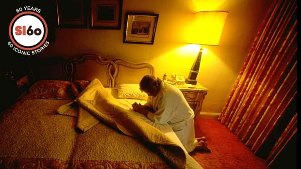 Marge Schott praying