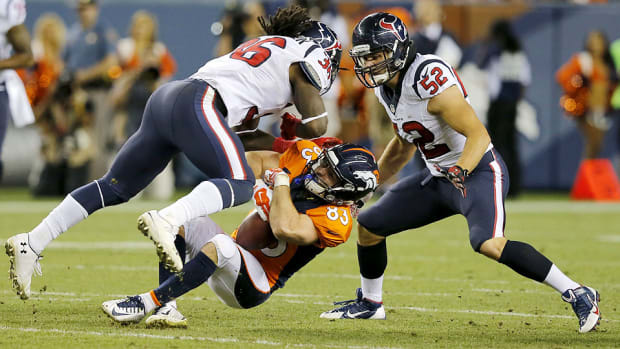 Broncos receiver Wes Welker takes a hit from Texans safety D.J. Swearinger