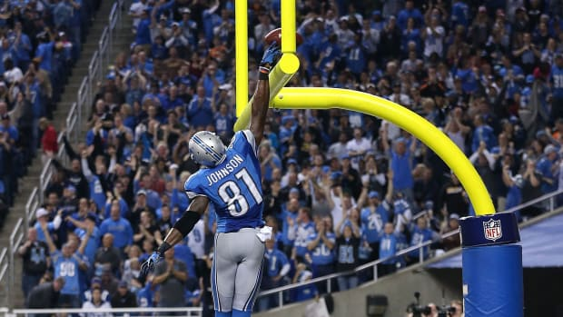 calvin-johnson-dunking