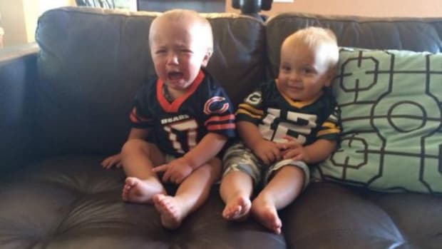 Green Bay Packers baby smiles while Chicago Bears Baby Cries