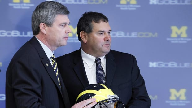 Michigan AD Dave Brandon defends Brady Hoke