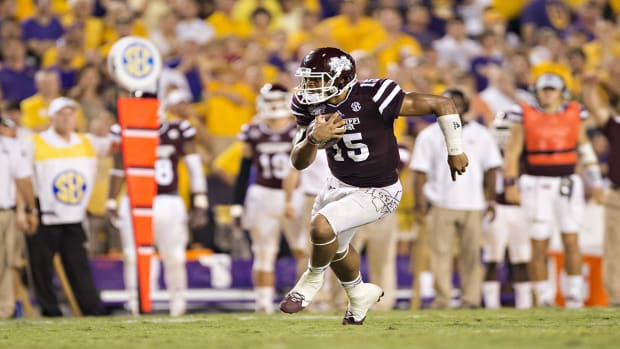 Mississippi State QB Dak Prescott would enter NFL Draft if projected as first-round pick