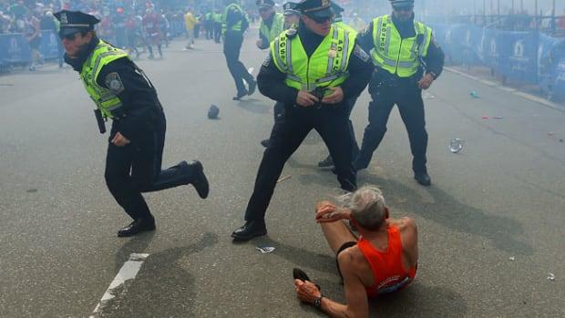 130416000708-boston-marathon-bombings-man-falls-single-image-cut.jpg