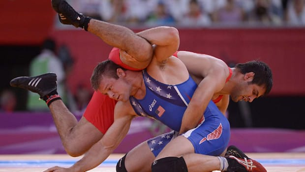 130403201842-wrestling-single-image-cut.jpg