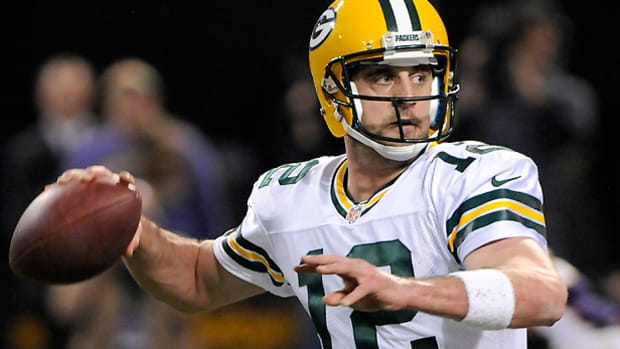 Aaron Rodgers' contract sets the pace for a number of other passers. (Jim Mone/AP)