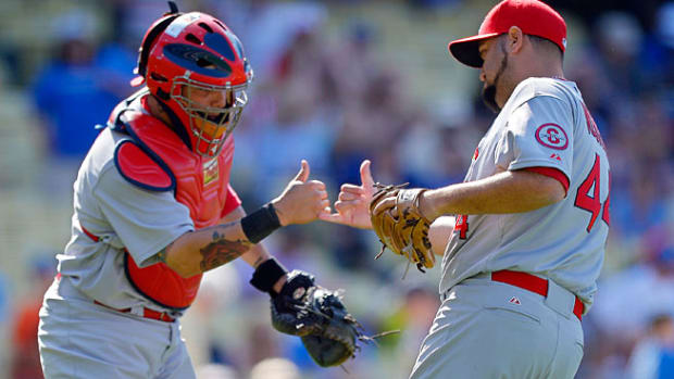 130611091126-yadier-molina-edward-mujica-ap2-single-image-cut.jpg