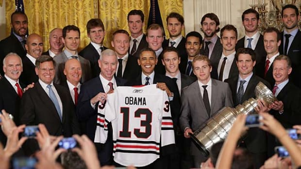 131104153833-obama-blackhawks-single-image-cut.jpg