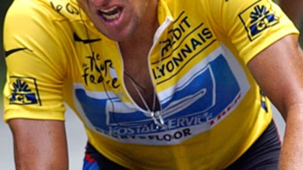 130116004805-lance-armstrong-riding-single-image-cut.jpg