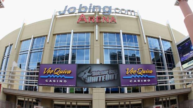 Tampa Bay Lightning's Nikita Kucherov (86) dodges the check from Edmonton Oilers' Mark Arcobello (26) during the second period of an NHL hockey game in Edmonton, Alberta, on Sunday, Jan. 5, 2014. (AP Photo/The Canadian Press, Jason Franson)
